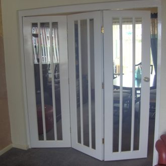 white folding room divider doors