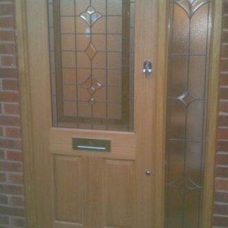 classic wood front door with glass