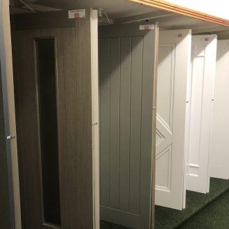 white & grey doors in City Glass & Doors showroom