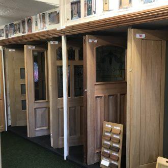 wooden doors in City Glass & Doors showroom