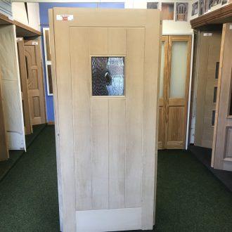 oak door in City Glass & Doors showroom